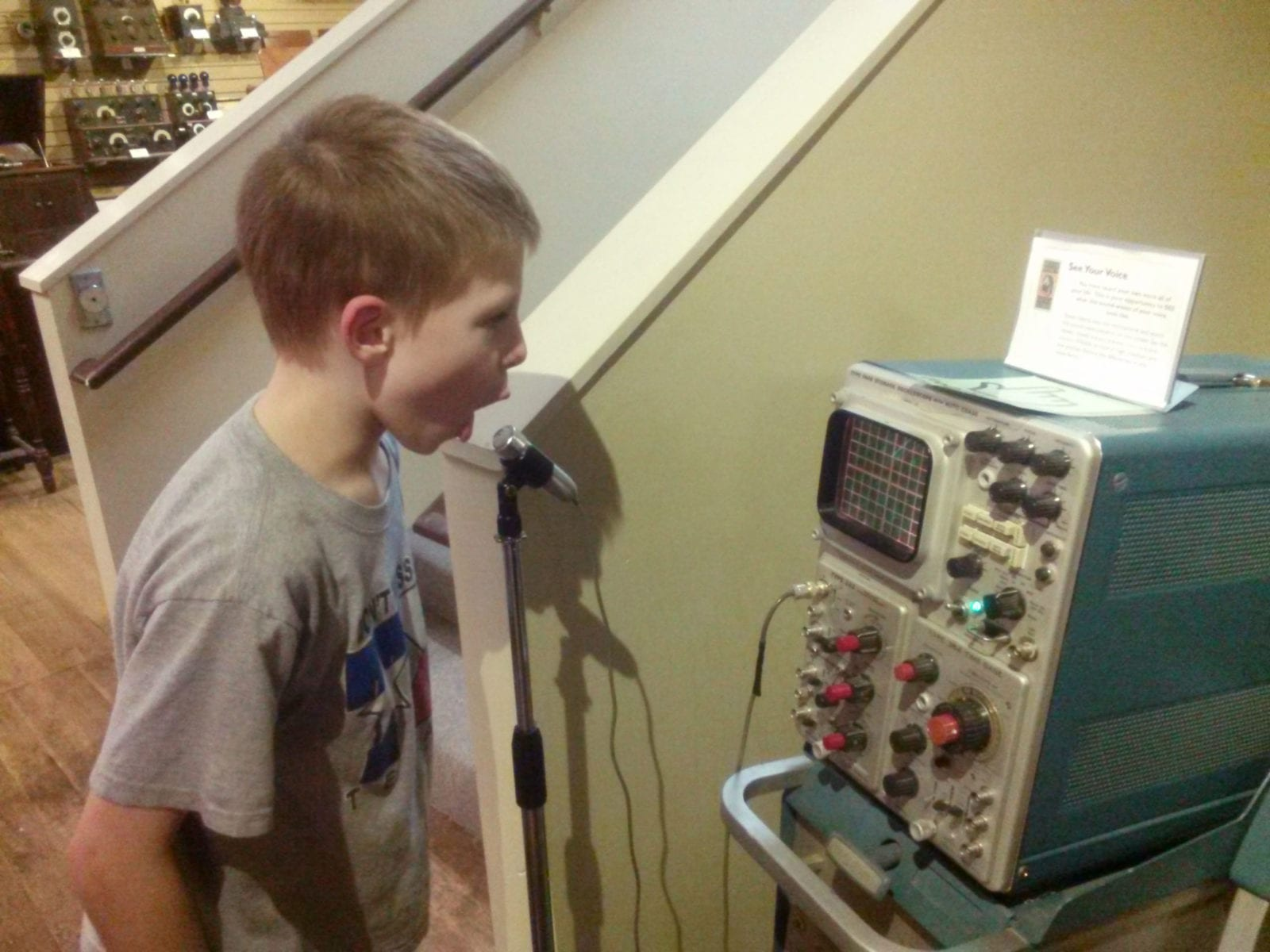 Boy watches sound waves at SPARK Museum, Belingham, WA
