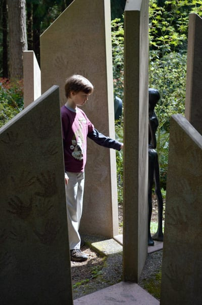 Boy interacts with sculpture