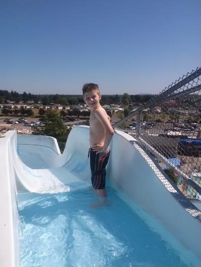 Boy atop the slides, Birch Bay Waterslides