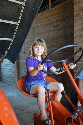 Girl on tractor, Hovander Homestead, Ferndale