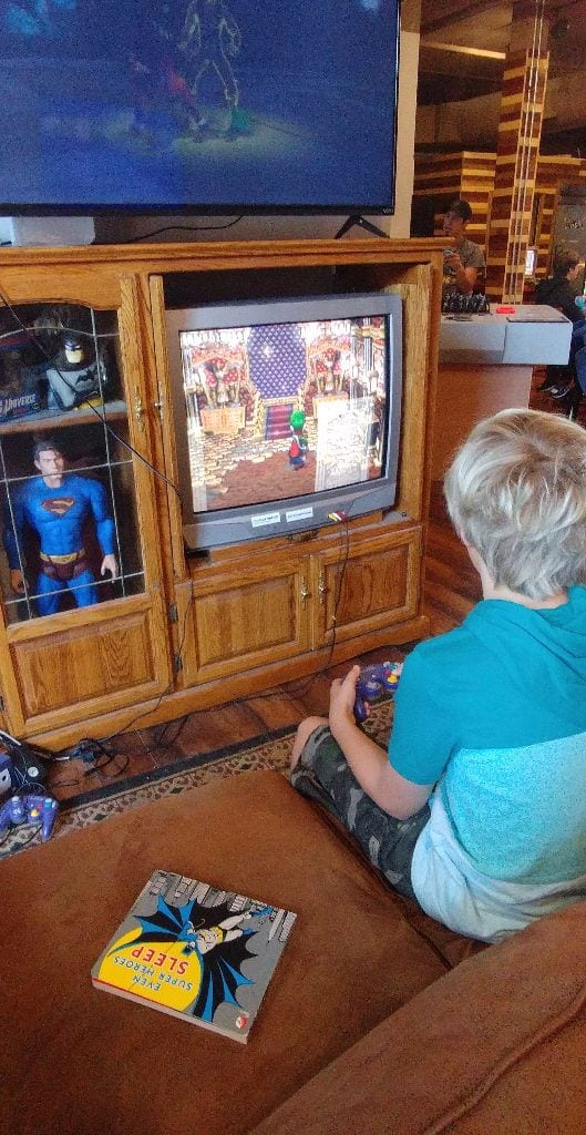Boy plays video game at Best Buds Gaming Lounge, Fairhaven