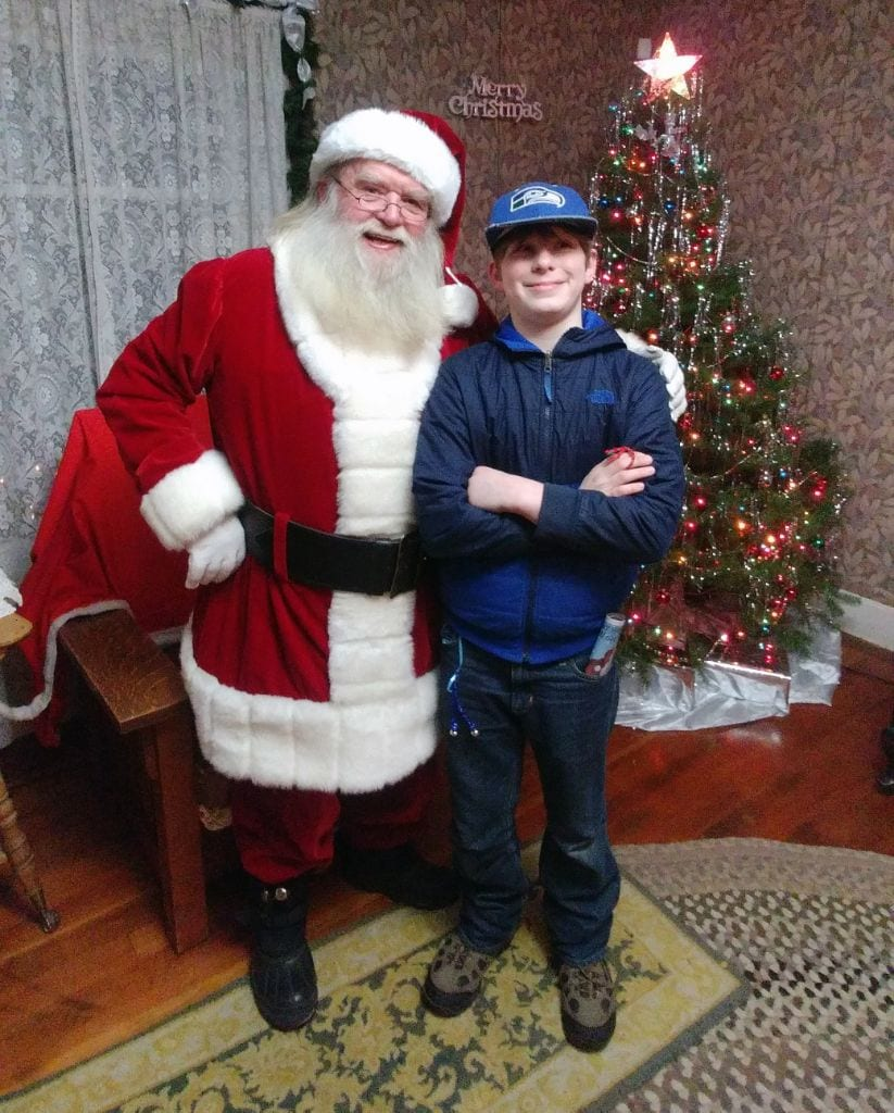 Santa Claus with boy at the Olde Fashioned Christmas