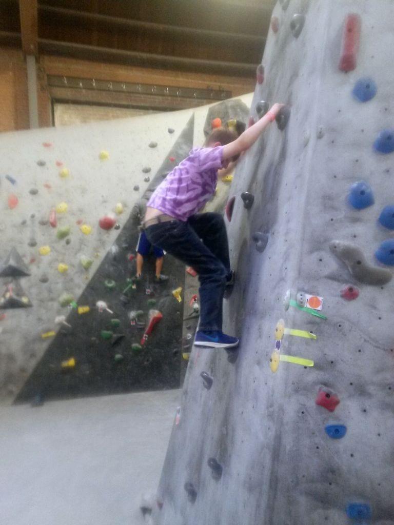 Boy climbing at Vital Climbing Gym, Bellingham