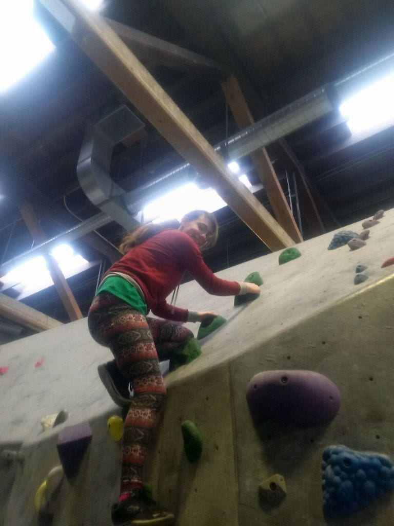 Girl climbing at Vital Climbing Gym