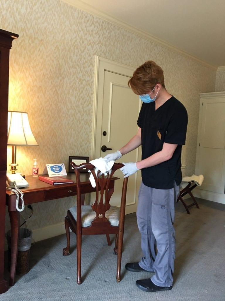 Fairhaven Village Inn, Housekeeping Member Leroy Ohana Cleans Guest Room
