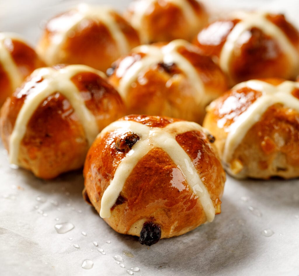 Hot Cross Buns, Freshly Baked Hot Cross Buns On White Parchment Paper, Close Up. Traditional Easter Food
